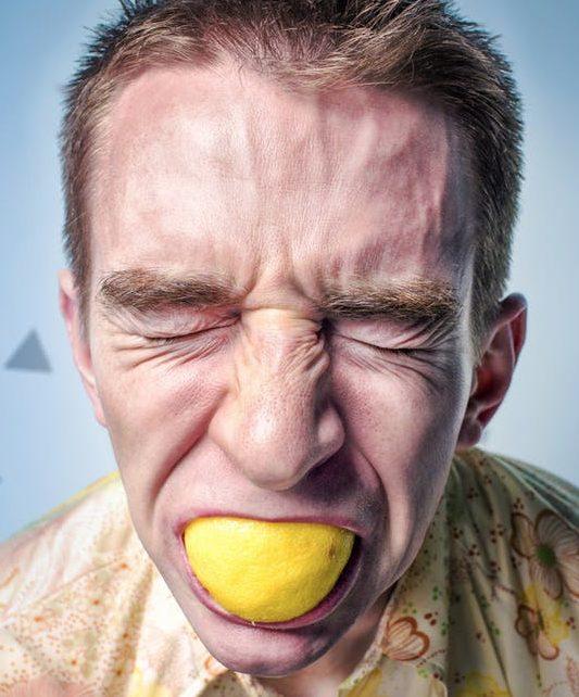 men sucking lemon